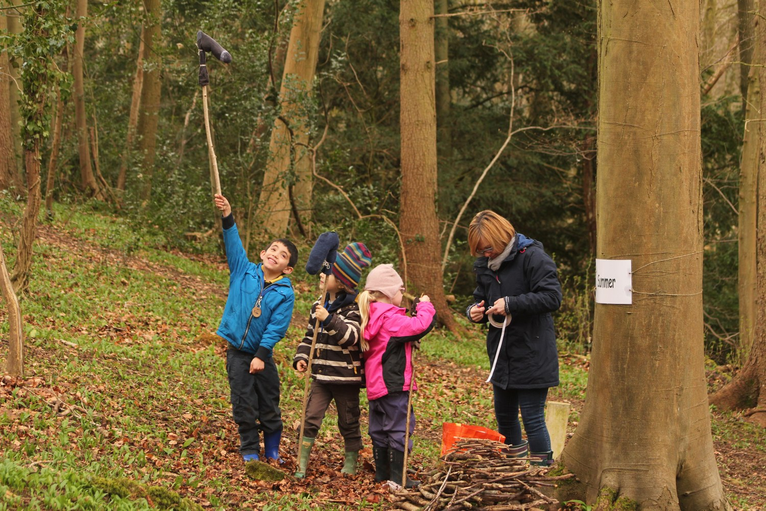 Children making crafts from gathered woodland branches
