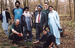 Sikh faith group planting trees in a wood