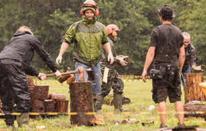 Foresters demonstrate forestry skills at an outdoor event