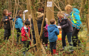 Group of children having a lesson in the woods