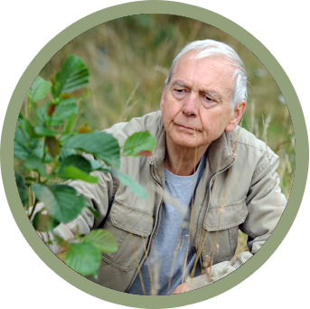 Journalist and presenter John Humphrys with a tree sapling
